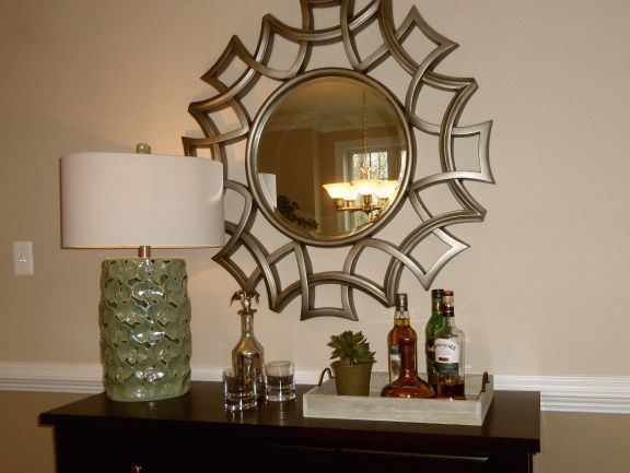 Living room bar detail; mirror, lamp, table